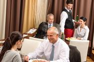 Stock Photo of business lunch restaurant people eating meal
