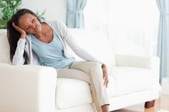 Woman on sofa in thoughts Stock Photos