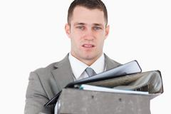 Stock Photo of Overwhelmed young businessman