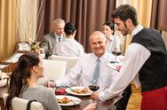 Business lunch waiter serving red wine Stock Photos