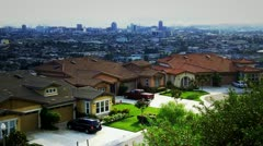 Suburban Houses With Downtown Building In Distance Zoom - stock footage