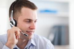 Close up of call center agent talking with costumer - stock photo