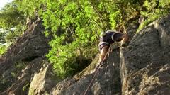 Guy on climbing wall Stock Footage