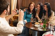 Friends at the bar man take picture Stock Photos