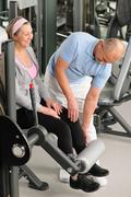 Physiotherapist assist active senior woman at gym Stock Photos