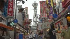 People going toTsutenkaku Tower, Osaka, Japan Stock Footage