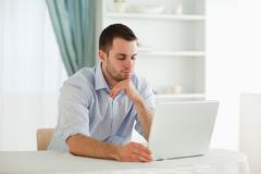 Businessman reading an e-mail Stock Photos