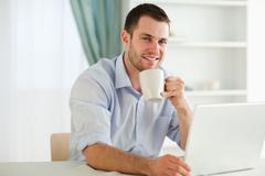 Stock Photo of Businessman enjoying a cup of coffee