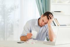 Businessman worried about bills Stock Photos