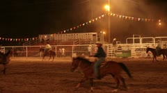 Cowboys riding in rodeo arena at night P HD 1195 Stock Footage