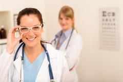 Doctor woman ophthalmologist white glasses Stock Photos