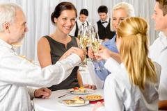 business partners toast champagne company event - stock photo