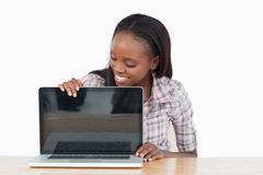 Stock Photo of Smiling student woman showing a screen
