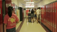 Teens goofing off in high school hallway Stock Footage