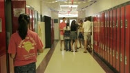 Stock Video Footage of teens goofing off in high school hallway