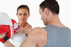 Confident looking female with her martial arts trainer - stock photo