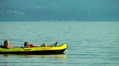 Couple in rubber dinghy 2/5 Stock Footage