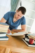 Student focused on his work - stock photo