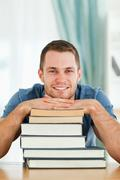 Student with his subject material - stock photo