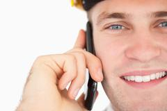 Stock Photo of Close up of a handsome architect making a phone call