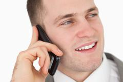 Stock Photo of Close up of a handsome entrepreneur making a phone call