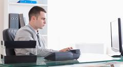Businessman writing an email Stock Photos