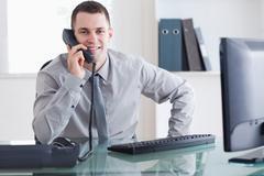Businessman getting good news - stock photo