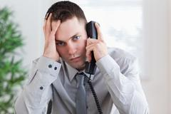 Stock Photo of Businessman getting bad news on the phone
