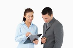 Stock Photo of Businesswoman showing data to her partner