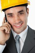 Close up of smiling architect listening to caller - stock photo