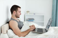 Stock Photo of Quiet man using a laptop