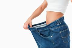 Stock Photo of Woman wearing too large pants