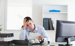 Businessman worried about invoice Stock Photos