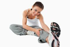 Young woman getting warmed up before workout - stock photo