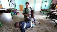 A Missionary Visits an Orphanage in Kenya, Africa. - stock footage