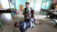 Stock Video Footage of A Missionary Visits an Orphanage in Kenya, Africa.