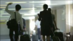 Pilots and flight attendants going in the plane - stock footage