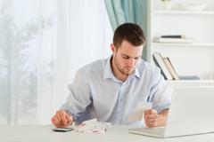 Businessman calculating his expenses Stock Photos