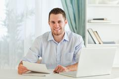 Stock Photo of Smiling businessman holding a letter