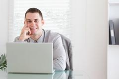 Businessman getting good news via email - stock photo