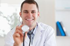 Stock Photo of Smiling doctor with stethoscope