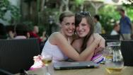 Stock Video Footage of Portrait of young happy girlfriends in outdoor bar HD