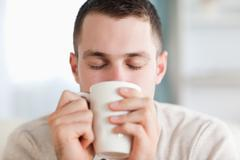 Stock Photo of Calm man having a coffee