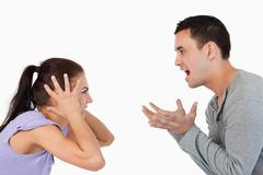 Stock Photo of Young couple yelling at each other