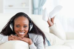 Stock Photo of Smiling woman with headphones on