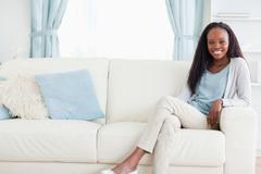 Woman leaning back on sofa Stock Photos