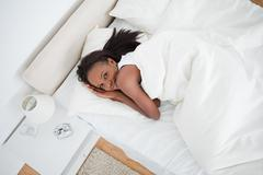 Stock Photo of Above view of a woman waking up