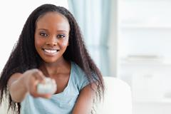 Stock Photo of Close up of woman with remote control