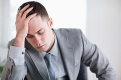 Stock Photo of Close up of businessman after getting bad news