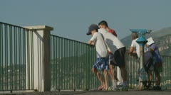 Santa Marinella, tourists observing bathers (slo motion) Stock Footage